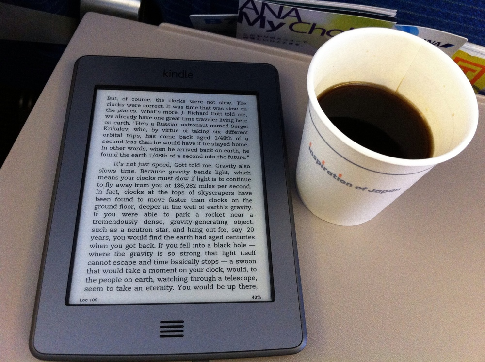Using your Kindle on a long haul flight - The Essential Travel Gear for Long Haul Flights - image by flicker user Yosomono
