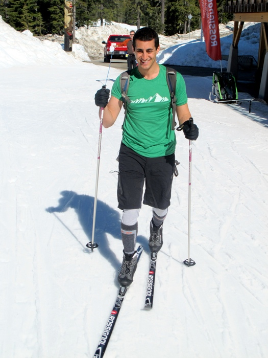 Chilly skiing in a t-shirt image by Flickr user Christopher Porter - Tips for Traveling in the Winter Months
