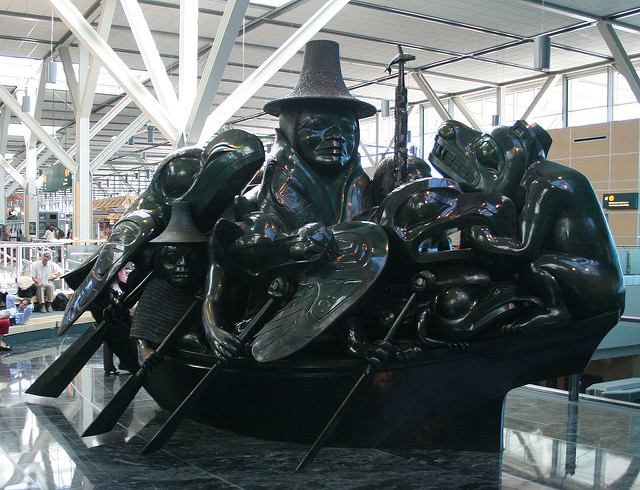 Jade Canoe the spirit of Haida Gwaii art sculpture at Vancouver airport image by Flickr user Tony Hisgett